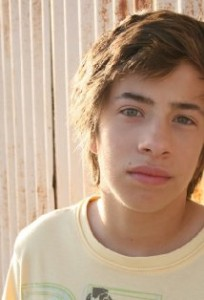 Jimmy Bennett plays the son, JJ Powell, in No Ordinary Family